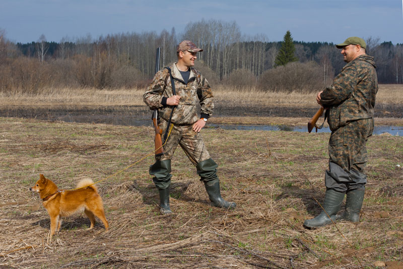 Two hunters and a dog