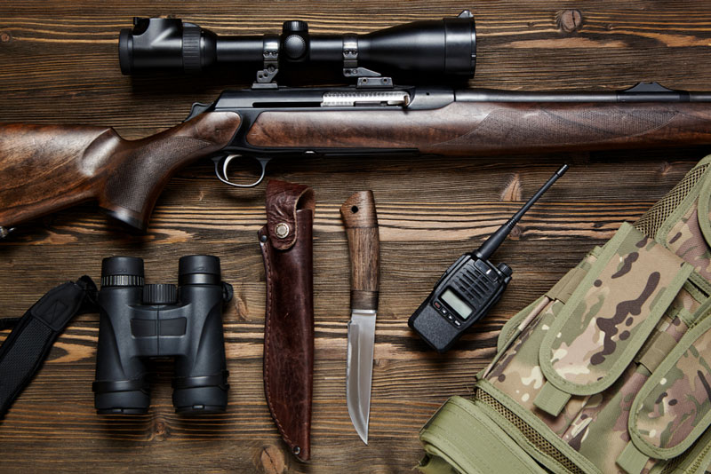 Hunting gear on wood table