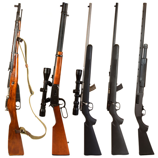 Assortment of hunting rifles stood up on end in a row