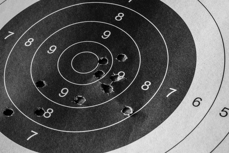Target practice bulls-eye sheet with bullet holes